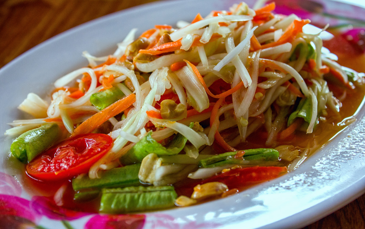 Papaya salad - very spicy and very easy to make. The main ingredients are shredded green papaya, beans, tomoato and chilli. Koh Samui, Thailand, 2012.