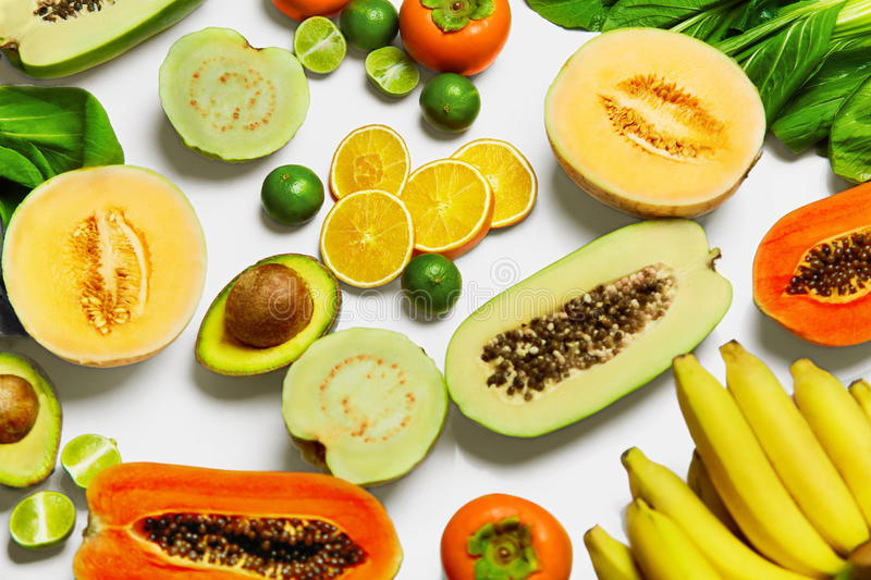 healthy-nutrition-organic-vegetables-fruits-food-ingredients-fresh-bok-choy-papaya-salad-persimmon-avocado-lime-bananas-melon-66529244