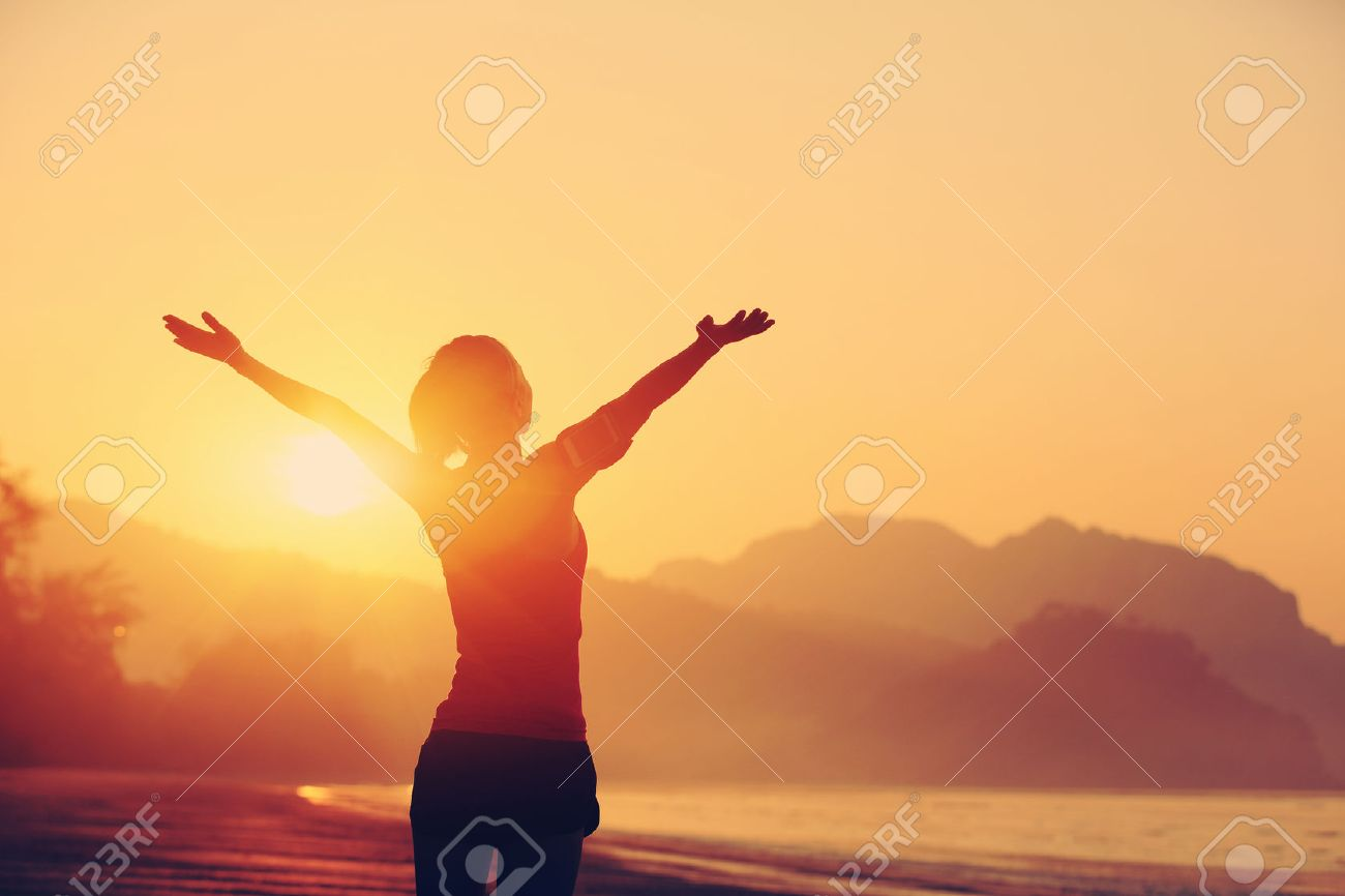 50636385-strong-confidence-woman-open-arms-under-the-sunrise-at-seaside