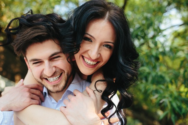 close-up-of-funny-lovers-smiling_1153-857