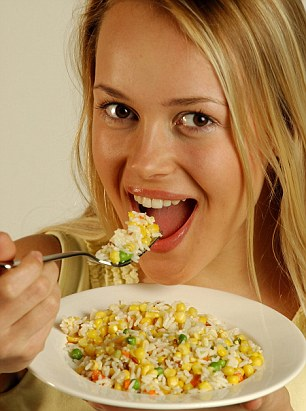 Model in studio eating rice salad.Pic Michael Thomas