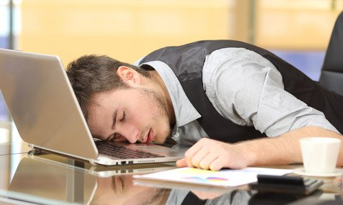 man-sleeping-on-desk-500