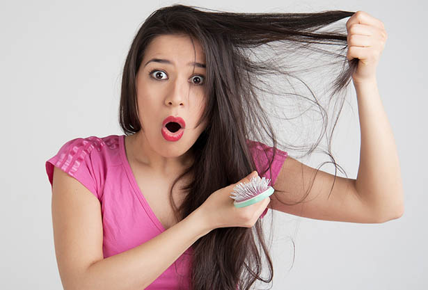 Young woman shocked state of hair on the head